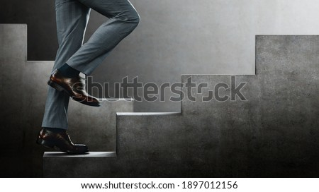 Motion image. Motivation and challenging Concept. Steps Forward into a Success. Low Section of Businessman Walking Up on Staircase. Sureal place