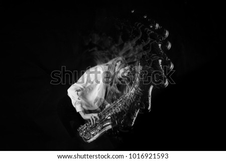 Motion Music with jazz musician in long exposure picture movements #1016921593