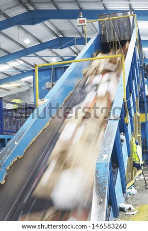 Motion of rubbish on conveyor belt in recycling factory