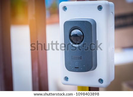 Motion sensor installed to control gate for home security system .