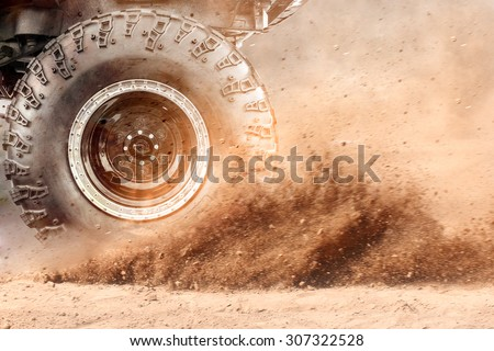 Motion the wheels tires and off-road that goes in the dust of the desert through the wheels on the sand #307322528
