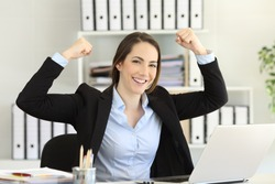 Motivated strong and confident businesswoman looking at camera at office