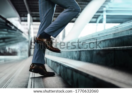 Motivation and challenging Concept. Steps Forward into a Success. Low Section of Businessman Walking Up on Staircase Сток-фото ©