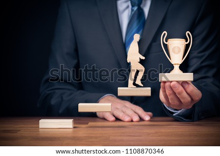 Motivation, personal development, personal and career growth, progress and potential concepts. Coach (human resources officer, manager, mentor) motivate employee to growth with cup for a winner.