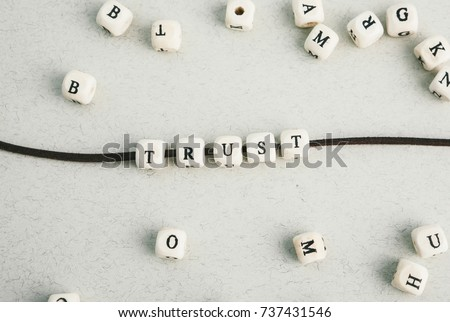 Motivation phrase Time is now from wooden beads strung on leather cord. Vertical composition. a series of photos with words and phrases #737431546