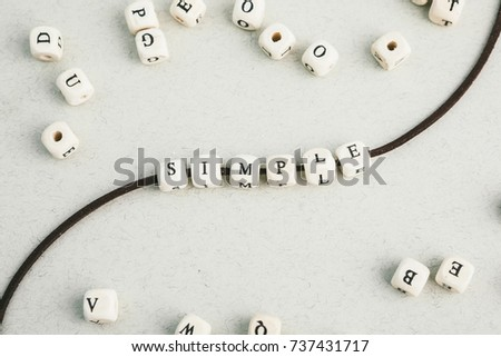 Motivation phrase Time is now from wooden beads strung on leather cord. Vertical composition. a series of photos with words and phrases #737431717