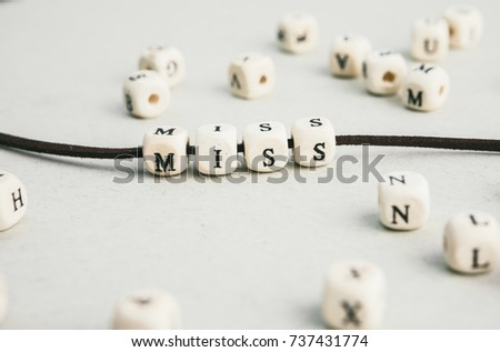 Motivation phrase Time is now from wooden beads strung on leather cord. Vertical composition. a series of photos with words and phrases #737431774