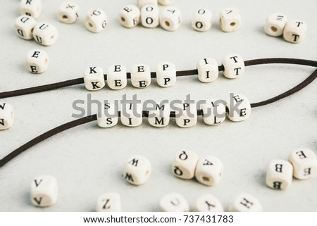 Motivation phrase Time is now from wooden beads strung on leather cord. Vertical composition. a series of photos with words and phrases #737431783