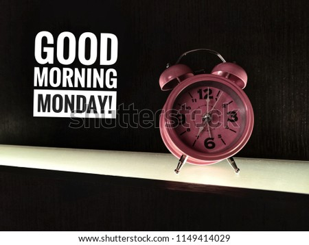 Motivation quotes concept image a pink clock and word - GOOD MORNING MONDAY! with black/dark vintage/ selective focus.