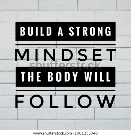 Motivational and inspirational quote - Build a strong mindset, the body will follow. With vintage styled background.