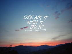 Motivational and inspirational quote of dream it wish it do it with sky and hills background. Stock photo.