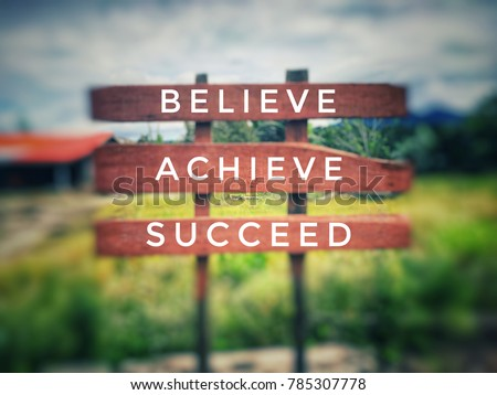Motivational and inspirational quotes - Believe, achieve, succeed. With blurred vintage styled background.