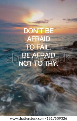 Motivational and inspirational quotes - Don't be afraid to fail. Be afraid not to try. Blurry sunset background.