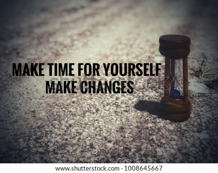 Motivational and inspirational quotes - Make time for yourself. Make changes. With blurred vintage styled background.