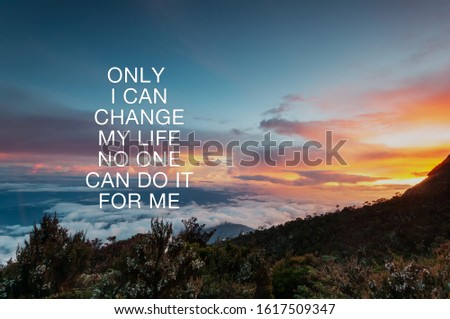 Motivational and inspirational quotes - Only i can change my life no one can do it for me. Blurry nature background.