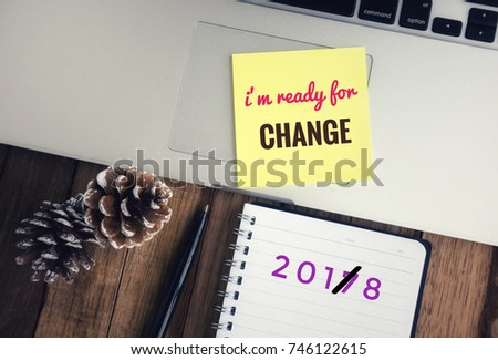 Motivational and inspirational wordings - ' I'm ready for change' wording on yellow stick note and '2018' writing on a notebook. #746122615