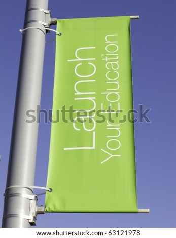 Motivational banner on campus of community college: Launch Your Education #63121978