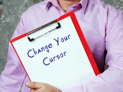 Motivational concept about Change Your Cursor with sign on the piece of paper.
