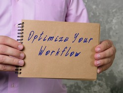 Motivational concept about Optimize Your Workflow with sign on the page.