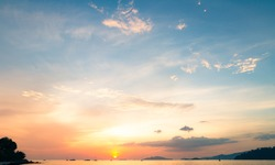 Motivational concept: Sea with yellow and blue sky with ocean sunrise background