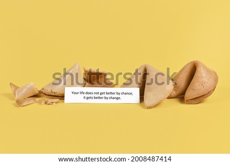 Motivational concept with note in fortune cookie saying 'Life does not get better by chance, it gets better by change' on yellow background Stock photo ©