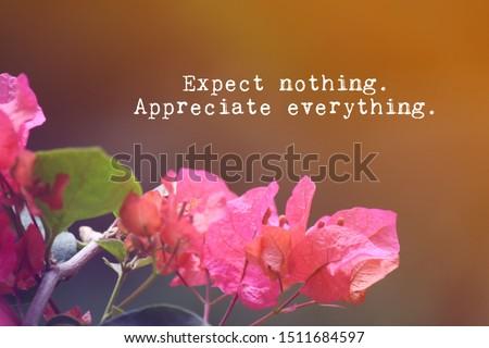 Motivational inspirational message on blur bokeh nature background.