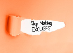 Motivational phrase Stop Making Excuses, written on a torn paper, encouraging action.