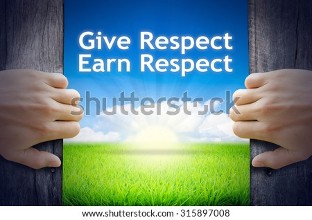 """Motivational quotes """"Give Respect Earn Respect"""" . Hands opening a wooden door then found a texts floating among new world as green grass field, Blue sky and the Sunrise."""