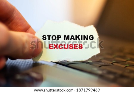 Motivational text Stop making excuses on paper on notebook background. Stock photo ©