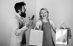motives for shopping. couple of shoppers. man shout on woman shopaholic. gift packages for holiday. seasonal discount. black friday. shop closeout. family couple go shopping. impulse purchase.