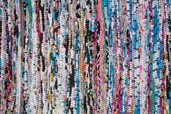 motley rug  textile fabrics texture in Scandinavian village style closeup