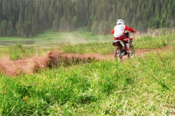 Motocross bike increase speed in track. Motorcyclist on off road, extreme sport, active lifestyle, adventure touring concept