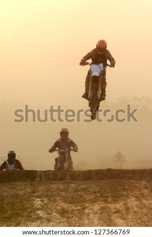 Motocross bike Jump in the sunset