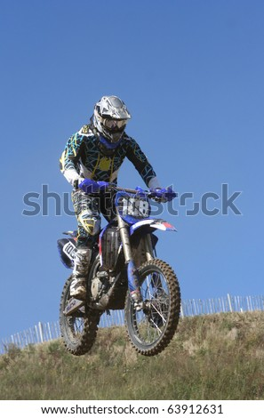 Motocross motorcycle jump : Shutterstock