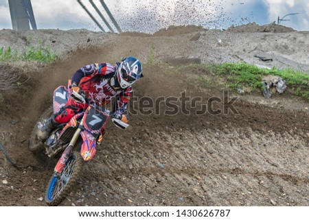 Motocross. Motorcyclist rushes along a dirt road, dirt flies from under the wheels.  Close-up. Active extreme rest. #1430626787