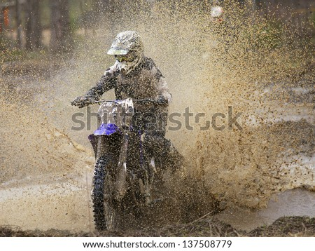 Motocross race on wet and muddy terrain in Parola Finland
