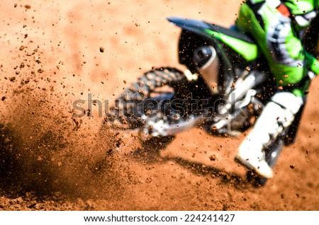 motocross racer accelerating in dirt track Stock photo ©