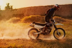 Motocross Rider At The Sunset