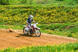 Motocross rider in the action