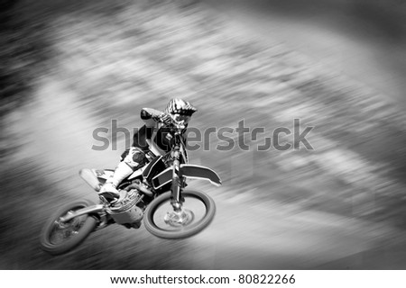 motocross rider in the air at high speed, black and white picture