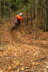 Motocross rider on a winding trail