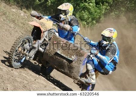 Motocross sidecar (Sidecarcross) team climb a hill : Shutterstock