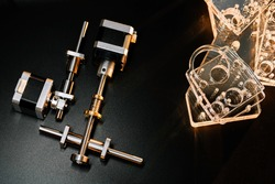 motor and guides for the laser machine. details of the engraving machine, black warm background, orange light
