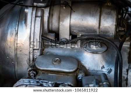 Motor bike detail - Engine block, Metal parts of motorcycle. #1065811922