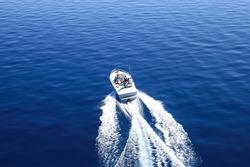 Motor boat or yacht on the lake Tahoe. Bird eye view.