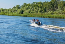 Motor boat with people moving  on a river