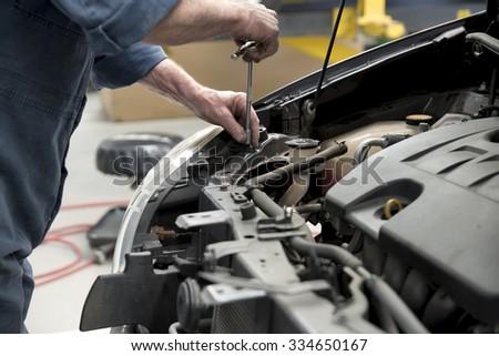 Motor car is repaired at a body repair shop #334650167