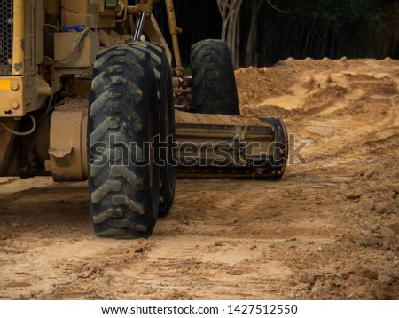 Motor grader is the basic construction of the road #1427512550