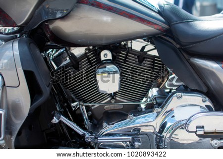 motor motorcycle closeup with reflection of the sun #1020893422