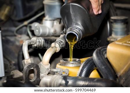 Motor oil pouring, oil change